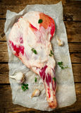 Raw lamb leg. On a wooden table. top view. style rustic . selective focus stock image