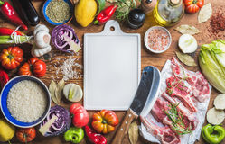 Raw lamb meat chops, rice, vegetables, oil, herbs and spices royalty free stock image