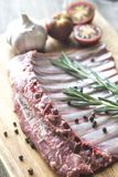 Raw lamb ribs with fresh rosemary Stock Photo