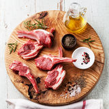 Raw lamb ribs with salt, pepper and cumin Stock Photos