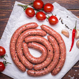 Raw lamb sausage with ingredients for salsa Stock Images