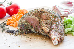 Raw lamb shank for cooking with vegetables Stock Photography