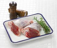 Raw lamb shank. On white butcher tray Royalty Free Stock Photo