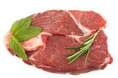 Raw Lamb steak with Rosemary and Mint Royalty Free Stock Photography