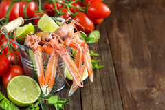 Raw langoustine in a bucket with vegetables. And herbs on wood Stock Images