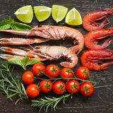 Raw langoustines and shrimps with vegetables Stock Image