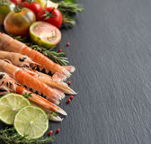 Raw langoustines with vegetables and herbs Stock Images