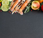 Raw langoustines with vegetables and herbs Stock Photography