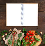 Raw lasagna pasta, vegetables and herbs with notebook Royalty Free Stock Photography