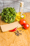 Raw lasagna with pepper and oil in the cooking process Stock Photography