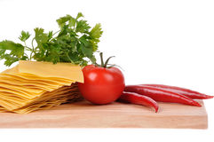 Raw lasagna, tomato and pepper Stock Image
