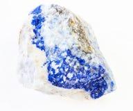 raw lazurite (lapis lazuli, lapis) stone on white
