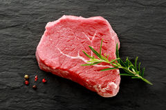 Raw lean rump steak waiting to be cooked Royalty Free Stock Photos
