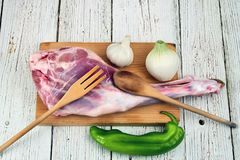 Leg of lamb before cooking. Raw leg of lamb before cooking with ingredien Royalty Free Stock Photo