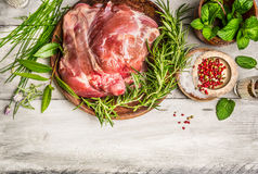 Raw leg of lamb with fresh herb on white rustic wooden background, top view. Place for text,frame Royalty Free Stock Photos