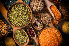 Raw legume on old rustic wooden table. Raw legume on old rustic wooden table, close-up Royalty Free Stock Photo