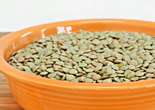 Raw lentil beans in a bowl.  Selective focus. Royalty Free Stock Photography