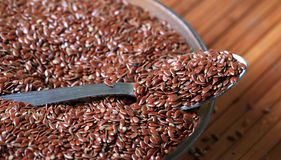 Raw linseed. Closeup shot of bowl of raw linseed's with wooden background Royalty Free Stock Photos