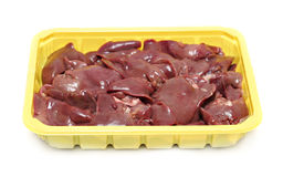 Raw liver in the plastic plate Stock Image