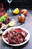 Raw liver. On plate,  and spice on a table Royalty Free Stock Photography