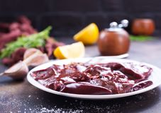 Raw liver. On plate,  and spice on a table Stock Image