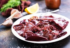 Raw liver. On plate,  and spice on a table Stock Photo