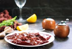 Raw liver. On plate,  and spice on a table Stock Images