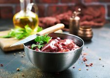Raw liver. With salt and spice on a table Royalty Free Stock Photo