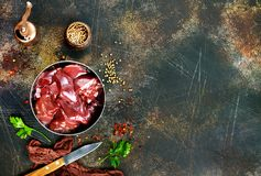 Raw liver. With salt and spice on a table Royalty Free Stock Photos