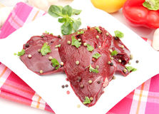 Raw liver. Some raw liver with pepper seeds Royalty Free Stock Photos