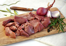 Raw liver on wooden board Stock Photo