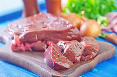 Raw liver. On wooden board Royalty Free Stock Photo