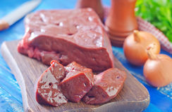 Raw liver. On wooden board Royalty Free Stock Image