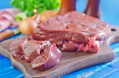 Raw liver. On wooden board Stock Image