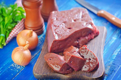 Raw liver. On wooden board Stock Images