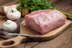 Raw loin on a chopping board. Royalty Free Stock Image