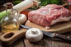 Raw loin on a chopping board. Prepare a meal of pork and vegetables Royalty Free Stock Photos