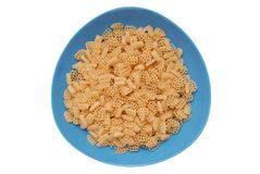 Raw macaroni in  blue plate Stock Image