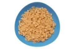 Raw macaroni in blue plate Stock Image