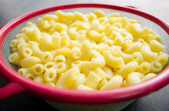 Raw macaroni in bowl. Ready for cooking Royalty Free Stock Photo