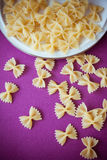 Raw macaroni farfalle Stock Photography