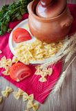 Raw macaroni farfalle Stock Images
