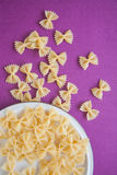 Raw macaroni farfalle Royalty Free Stock Photos