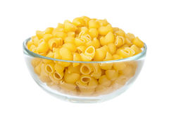Raw macaroni in glass dish Stock Image