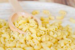 Raw macaroni pasta Stock Photos