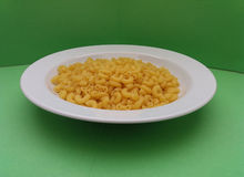 Raw macaroni pasta Stock Images