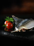 Raw Mackerel Fillets. Shot against a dark, rustic background with generous accommodation for copy space Royalty Free Stock Photos