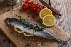Raw mackerel with lemon Stock Image