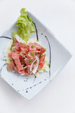 Raw Maguro Bluefin Tuna Spicy Salad in Japanese Painted Ceramic Dish royalty free stock image