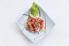 Raw Maguro Bluefin Tuna Spicy Salad in Japanese Painted Ceramic Dish royalty free stock images